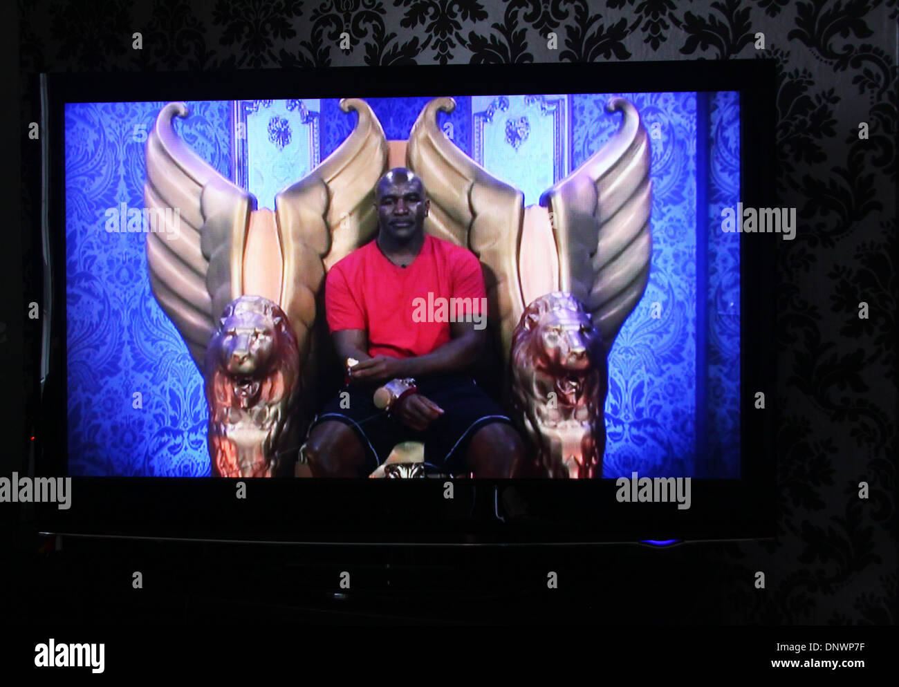 Celebrity Big Brother contestant and former world heavyweight boxing champion Evander Holyfield makes comments that being gay 'ain't normal' sparking backlash on social media. Programme broadcast on 5 January 2014. Holyfield is admonished by Celebrity Big Brother producers in the diary room. - Stock Image