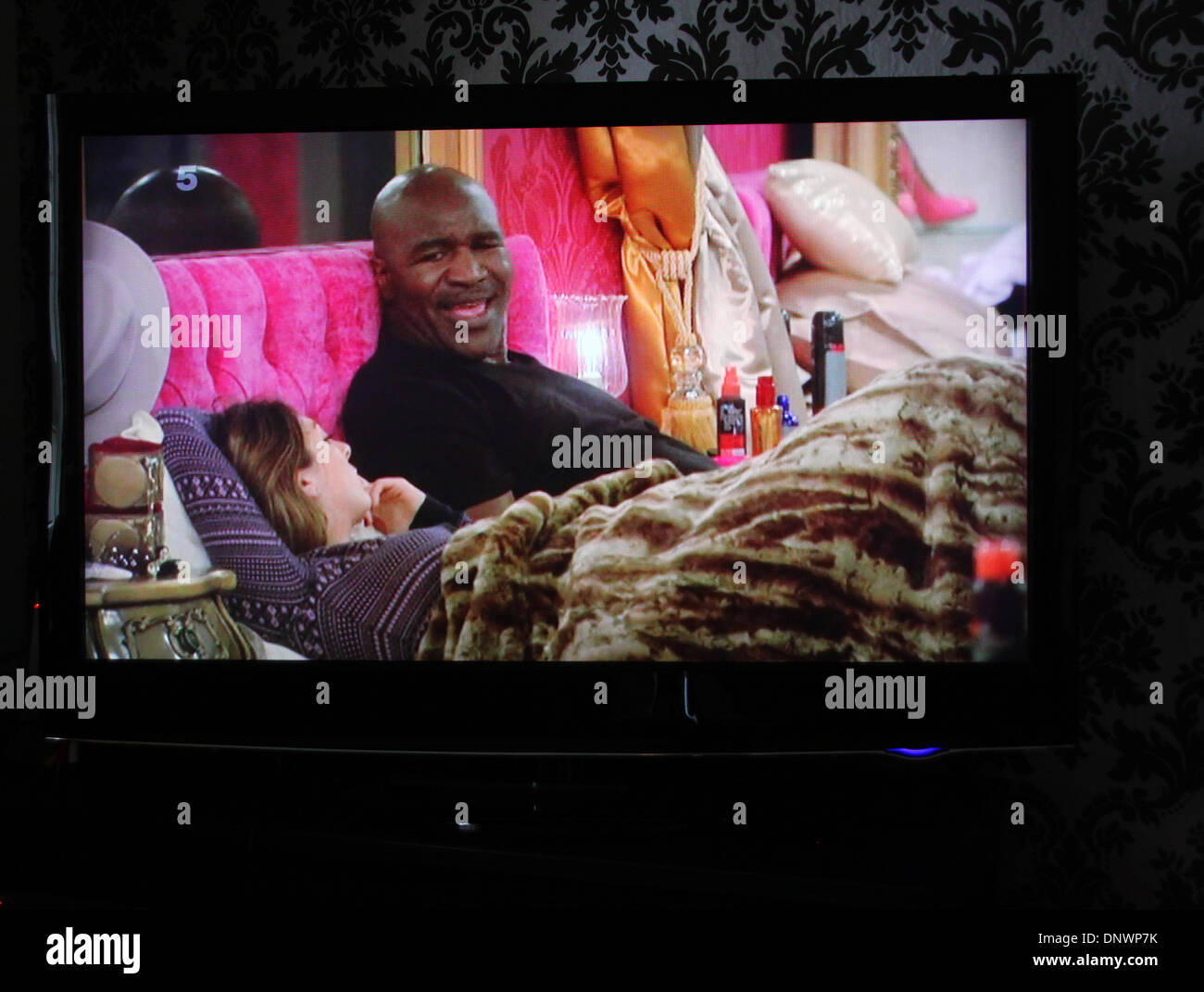 Celebrity Big Brother contestant and former world heavyweight boxing champion Evander Holyfield makes comments that being gay 'ain't normal' sparking backlash on social media. Programme broadcast on 5 January 2014. Holyfield makes his views known yo fellow housemate Luisa Zissman. - Stock Image