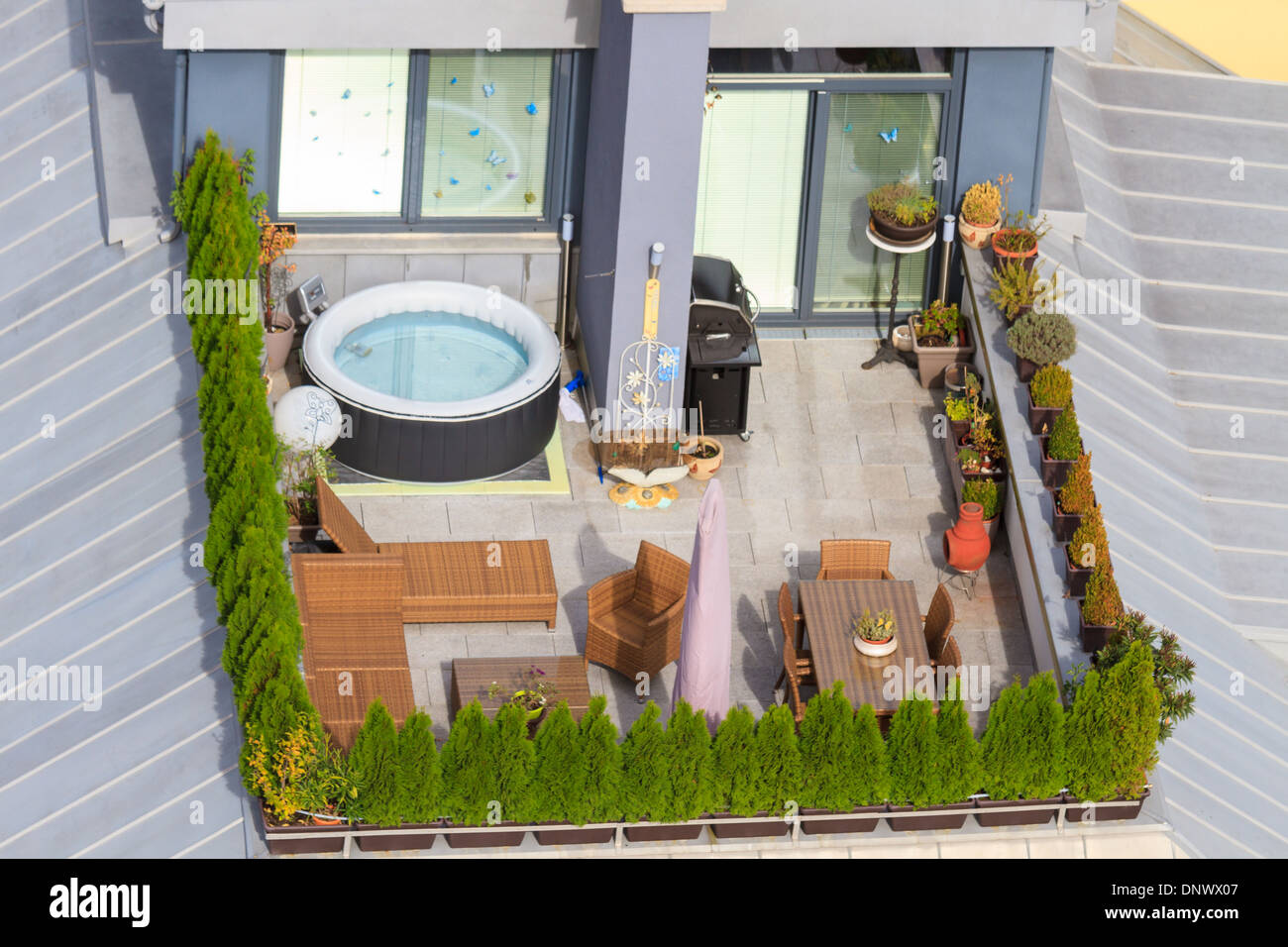 Terrace on the roof with green garden and jacuzzi tub Stock Photo ...