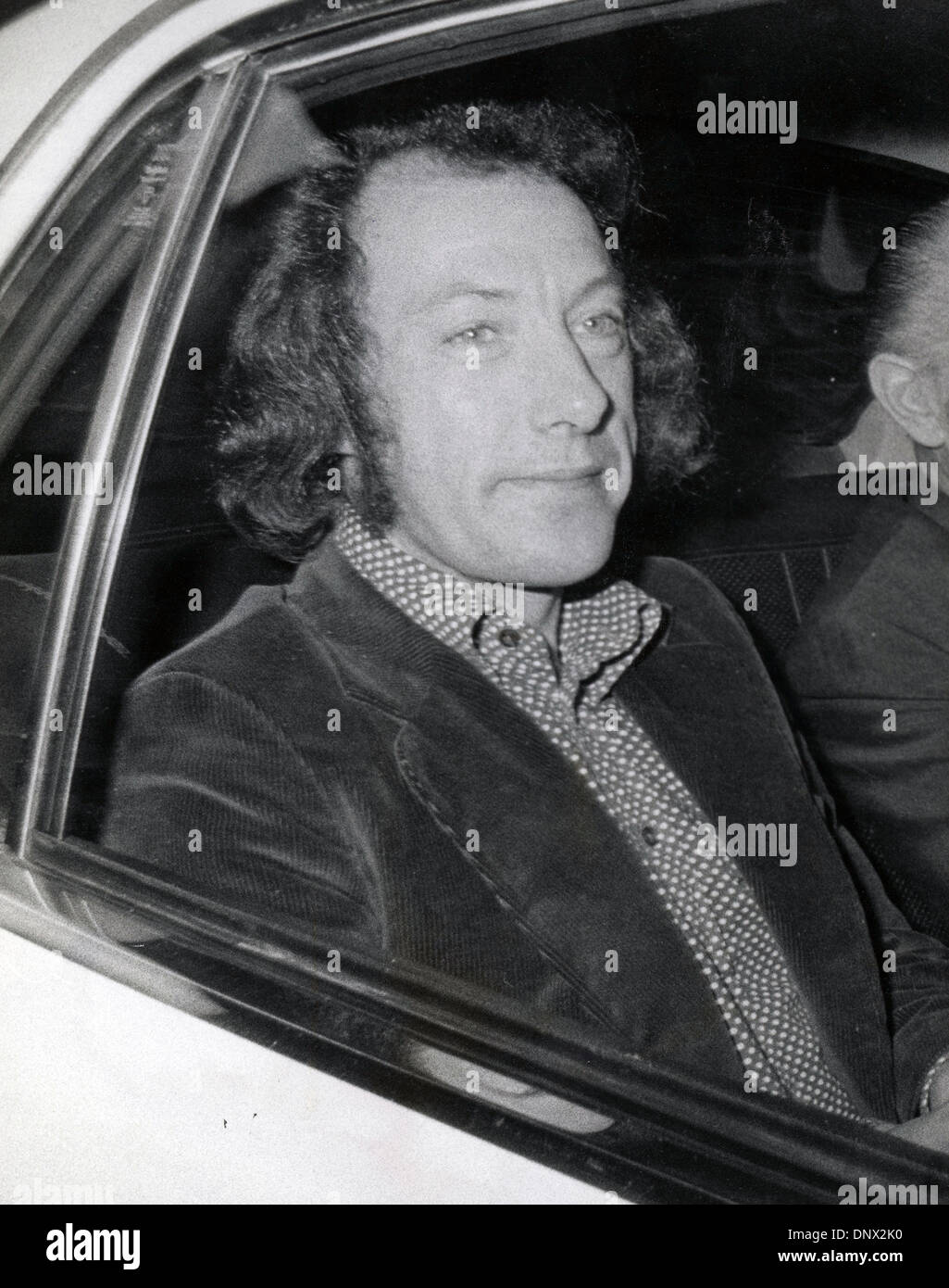 Apr 23, 1974 - London, England, United Kingdom - RONALD MILHENCH on his way to the Wolverhampton Magistrates Court in a police car from the Winson Green prison to stand trial for trying to obtain 25,000 pounds by means of a criminal deception from the Associated Newspapers. (Credit Image: © KEYSTONE Pictures/ZUMAPRESS.com) - Stock Image