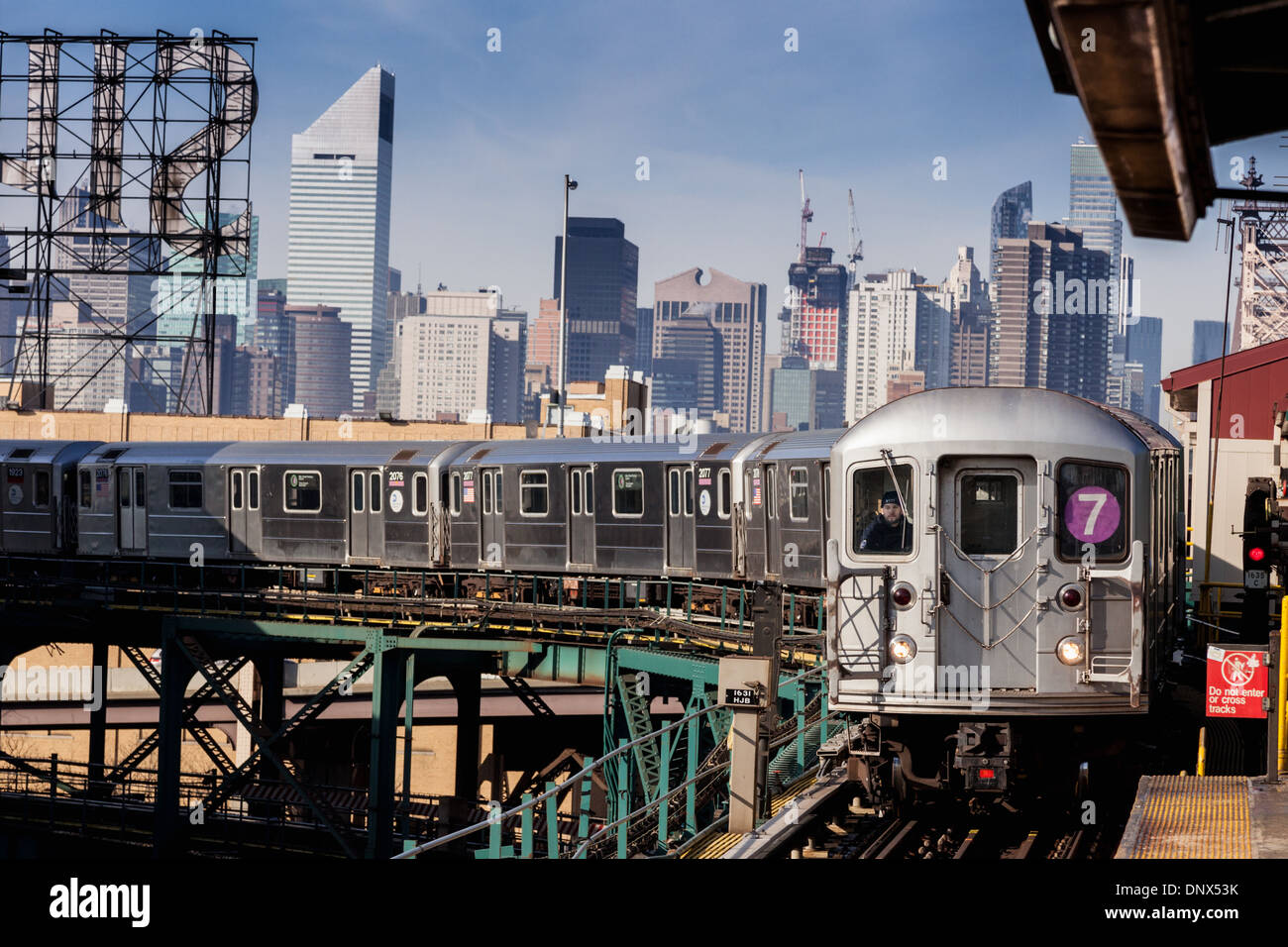 Number seven 7 train, Flushing bound, arrives at station in Queens, New York City - Stock Image