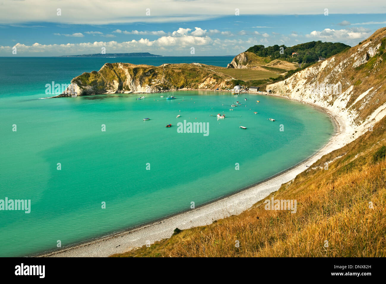 A view of Lulworth Cove, on the Jurassic Coast in Dorset UK photographed on a bright sunny day in September - Stock Image