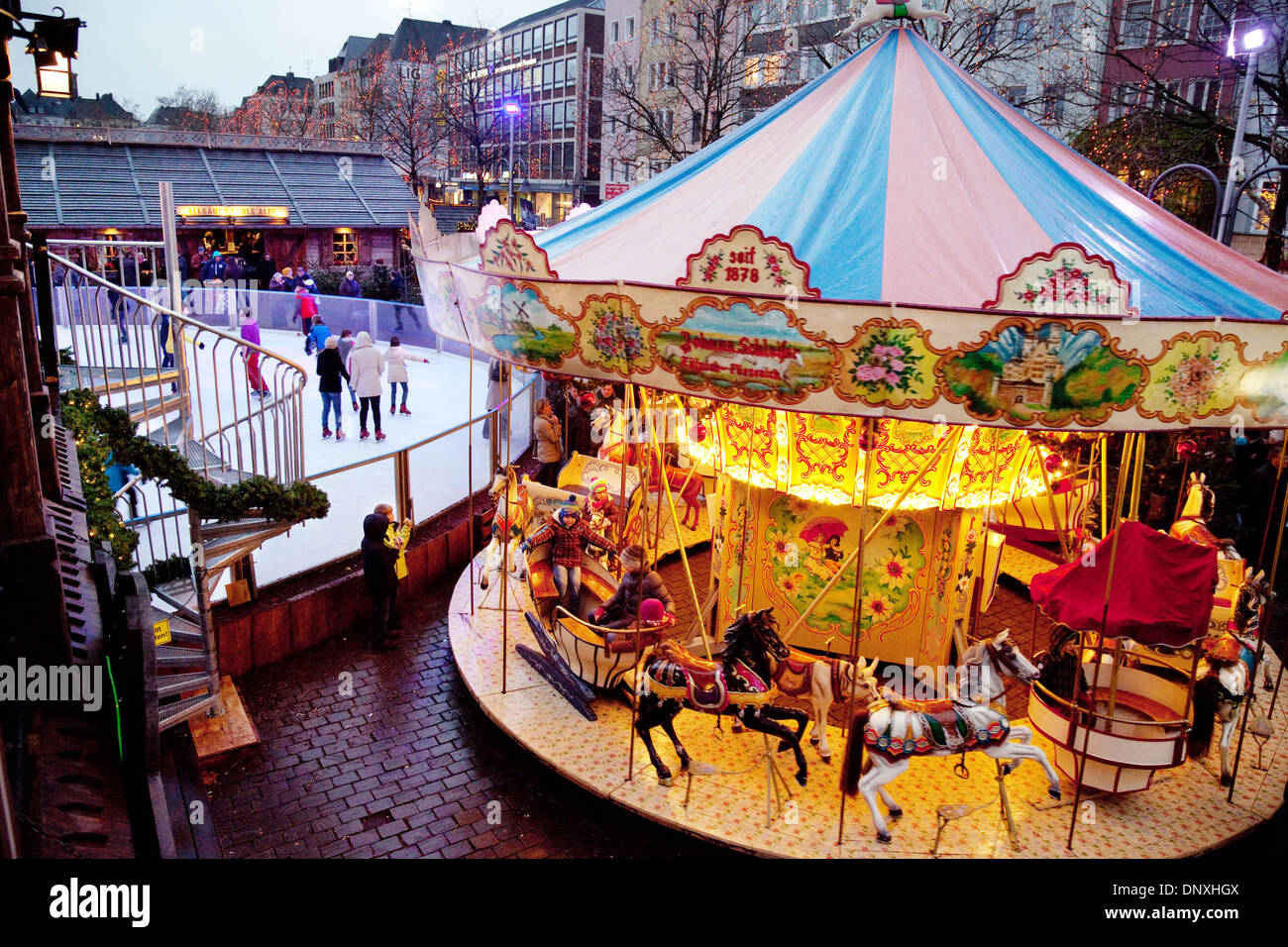 Cologne Christmas market, a carousel and ice-skating at the Alter Markt, Cologne ( Koln ), Germany Europe - Stock Image