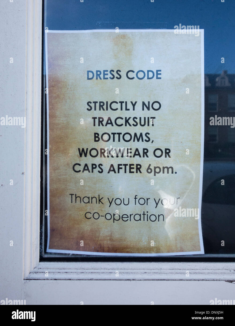 Dress code sign on pub dorr in north east England - Stock Image
