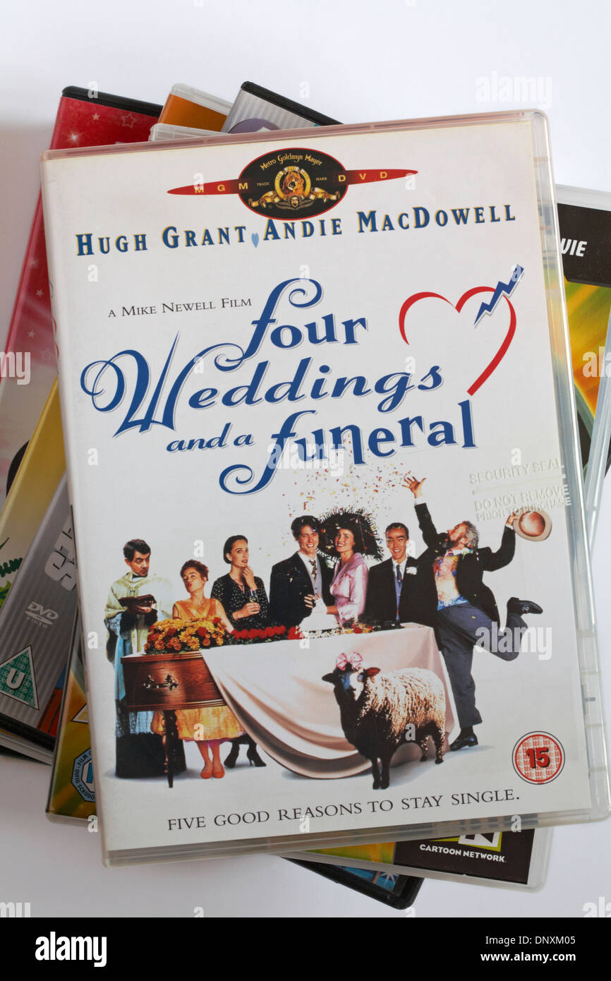 pile of DVDs with Four Weddings and a Funeral DVD on top - Stock Image