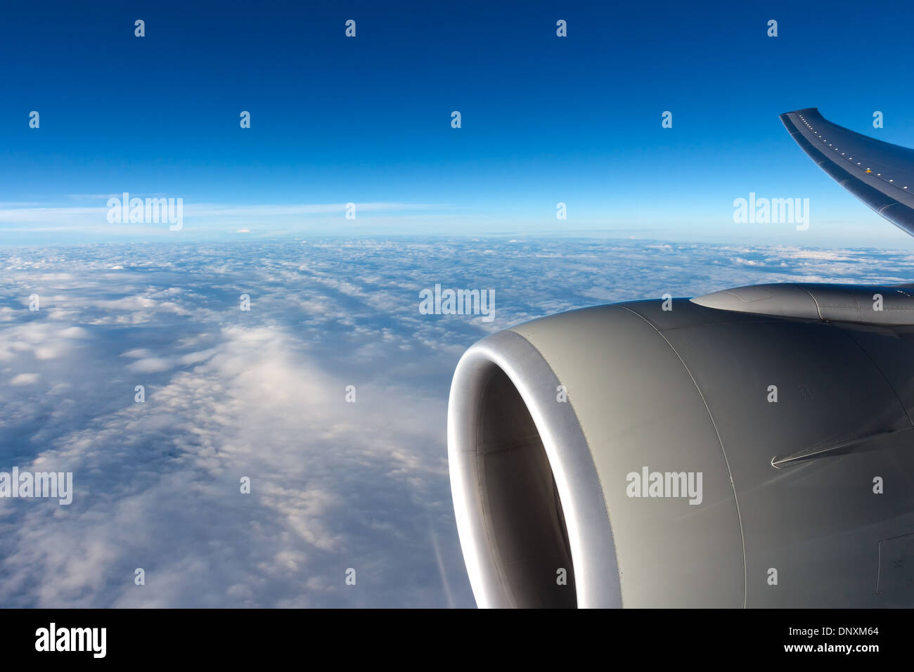 Clouds in the sky through aircraft window Stock Photo
