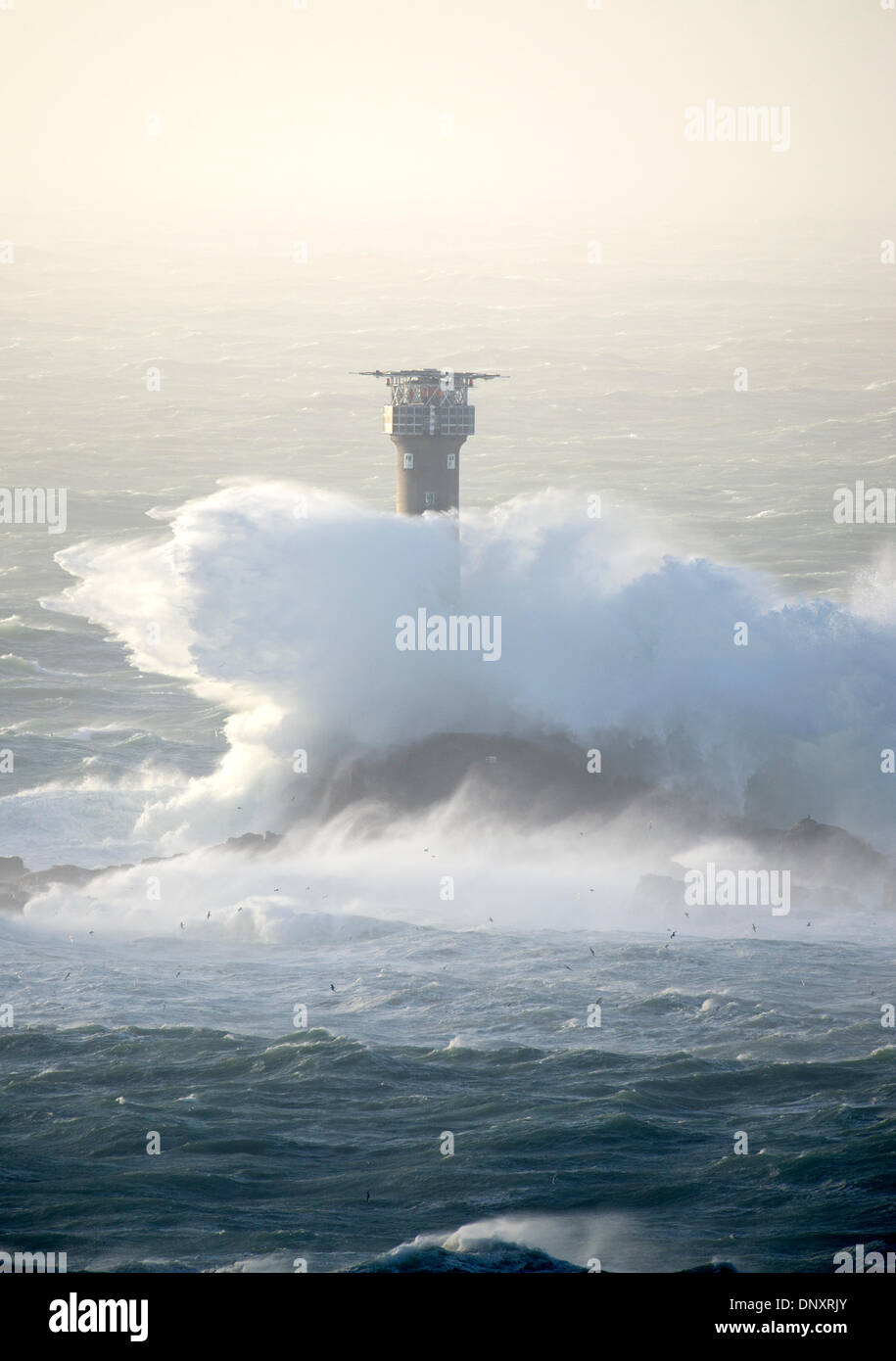 Lands End, UK. 6th Jan, 2014.  Storm Hercules, generates strong winds and waves that batter the Longships Lighthouse at Lands End, Cornwall, as stormy weather sweeps across the West of the UK. Credit:  Bob Sharples/Alamy Live News - Stock Image