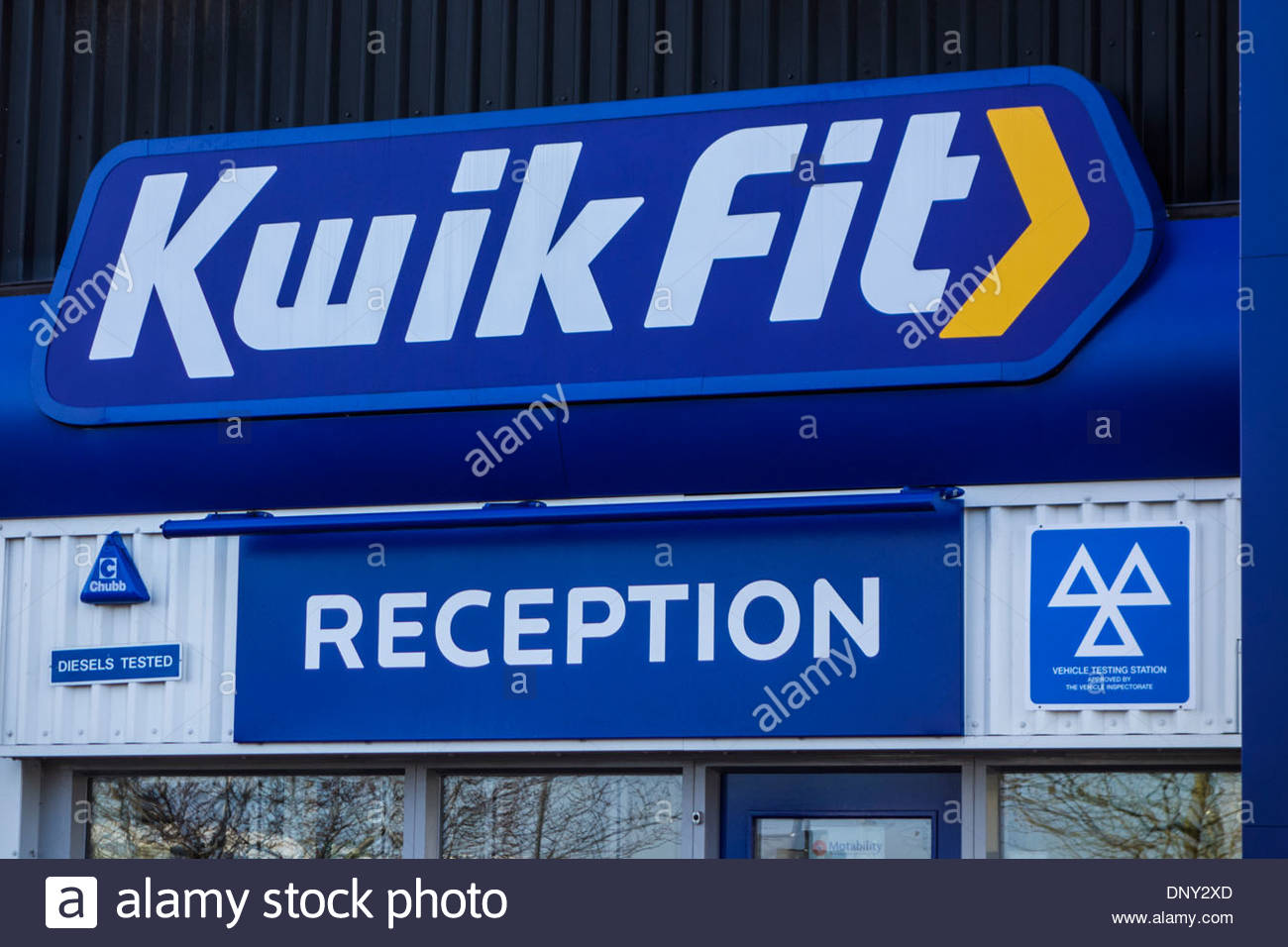 Kwik Fit reception sign on a branch of the car servicing business in Cambridge, England, UK - Stock Image