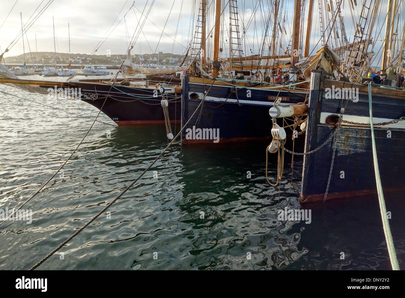 Bows of schooners on mooring in a harbour of Björko island. Bohuslan, Sweden. - Stock Image