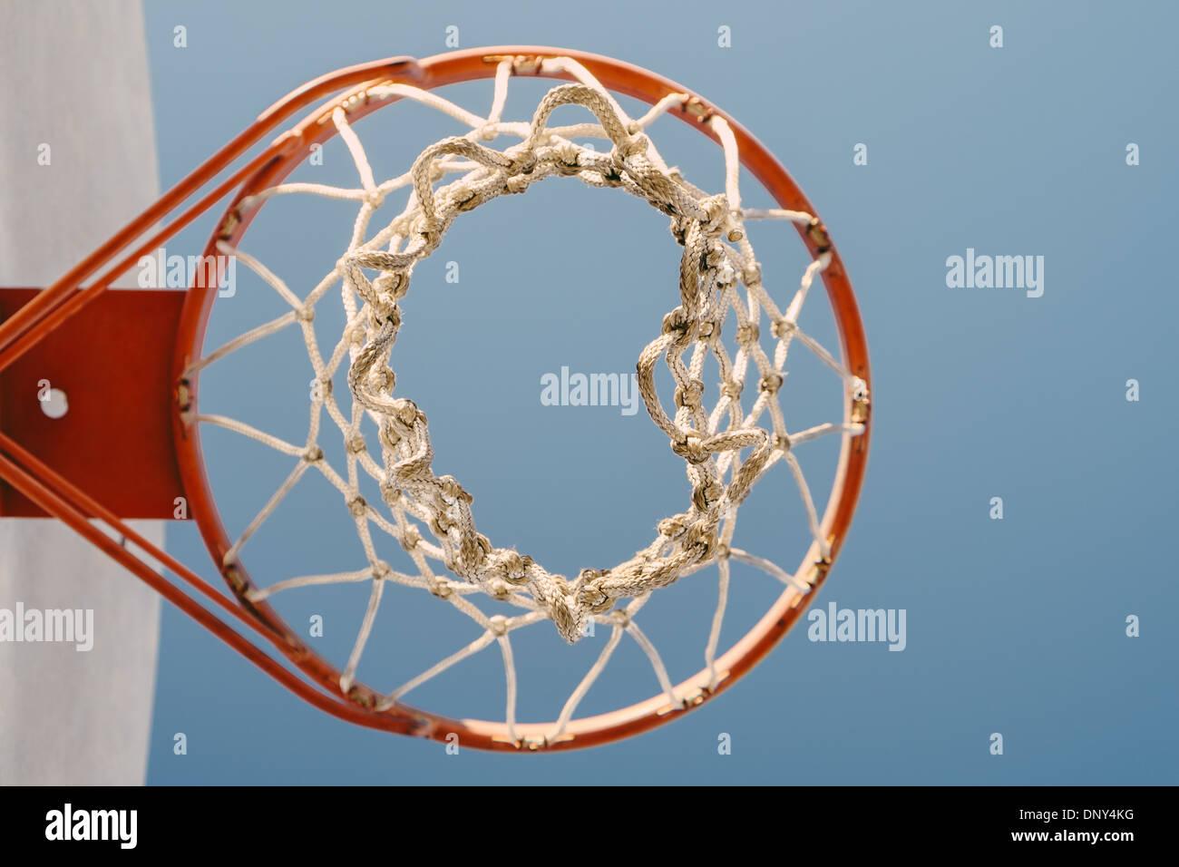 Basketball hoop against blue sky - Stock Image