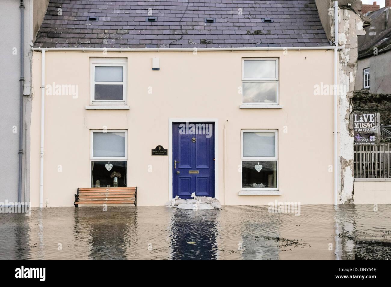 Portaferry, Northern Ireland. 6 Jan 2014 - A house narrowly avoids floodwater in Portaferry, Northern Ireland. The Stock Photo