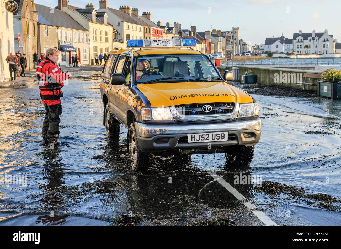 Portaferry, Northern Ireland. 6 Jan 2014 - A coastguard vehicle drives through seawater which has flooded the main Stock Photo