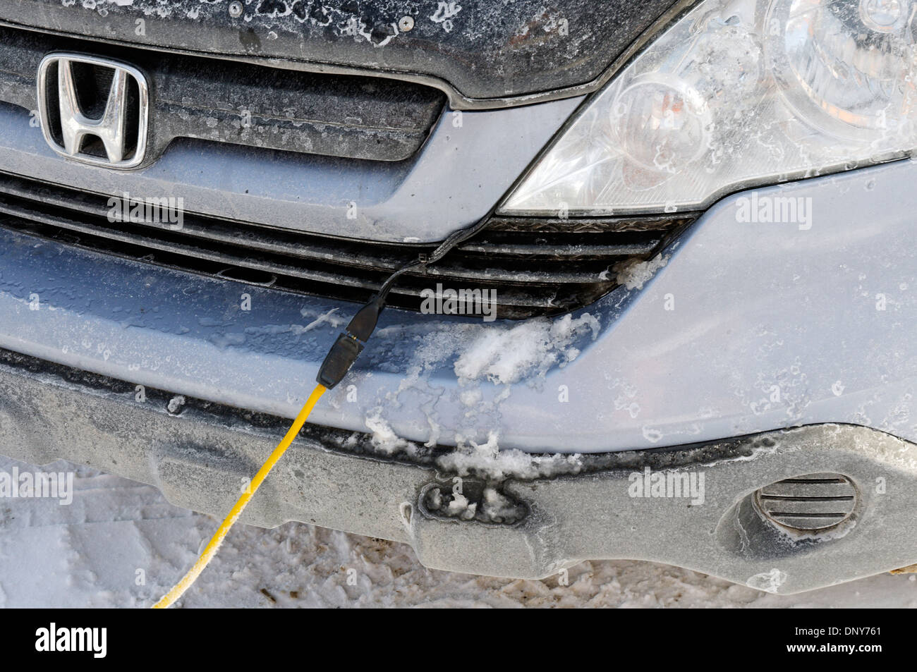 Canadian Winter - when its  -30C or less the engine oil gets very viscous so we plug in the block heater to ensure the car start - Stock Image