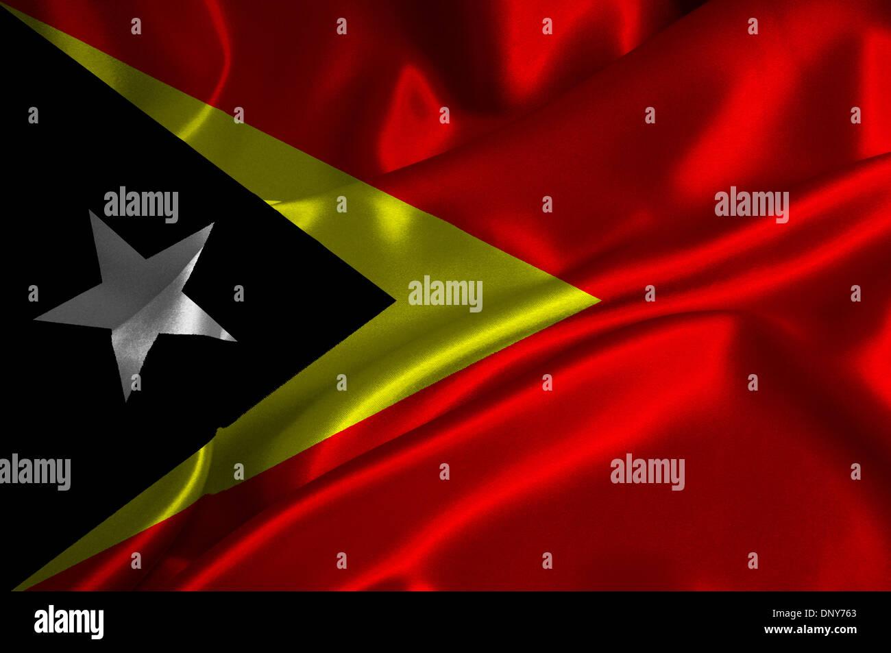 East Timor flag on satin texture. - Stock Image
