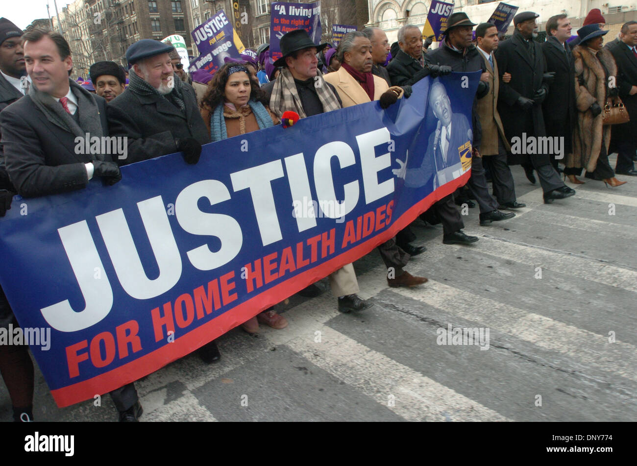 Jan 16, 2006; Manhattan, New York, USA; Nassau County Executive Tom Suozzi (L), 1199 SEIU President Dennis Rivera (4th from L) and Reverend Al Sharpton (5th from L) march as thousands of members and supporters of 1199 Service Employees International Union (SEIU) honor Dr. Martin Luther King with a march and rally in Harlem demanding justice for home health aides. 30,000 Aides provi - Stock Image