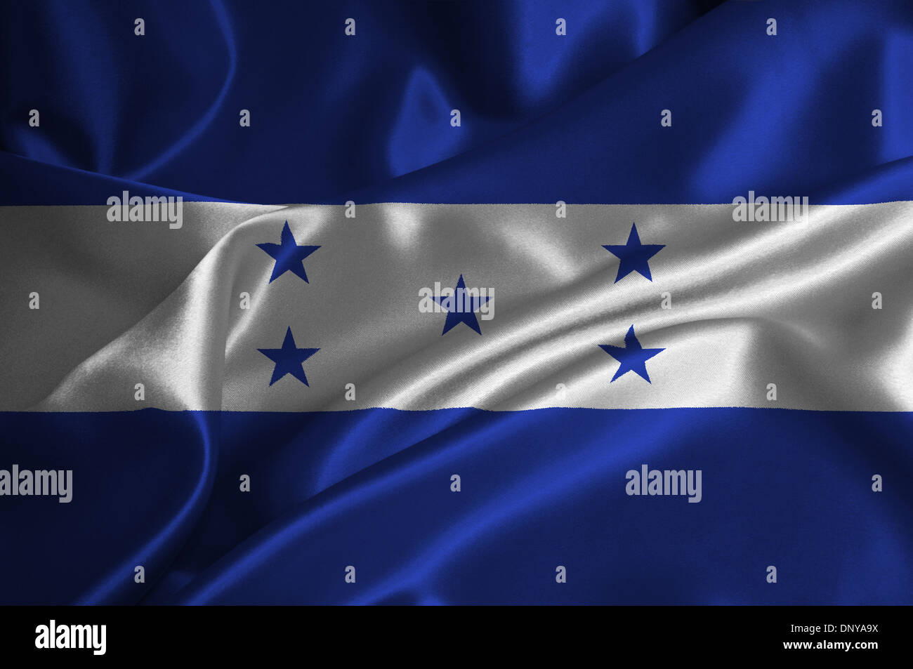 Honduras flag on satin texture. Stock Photo