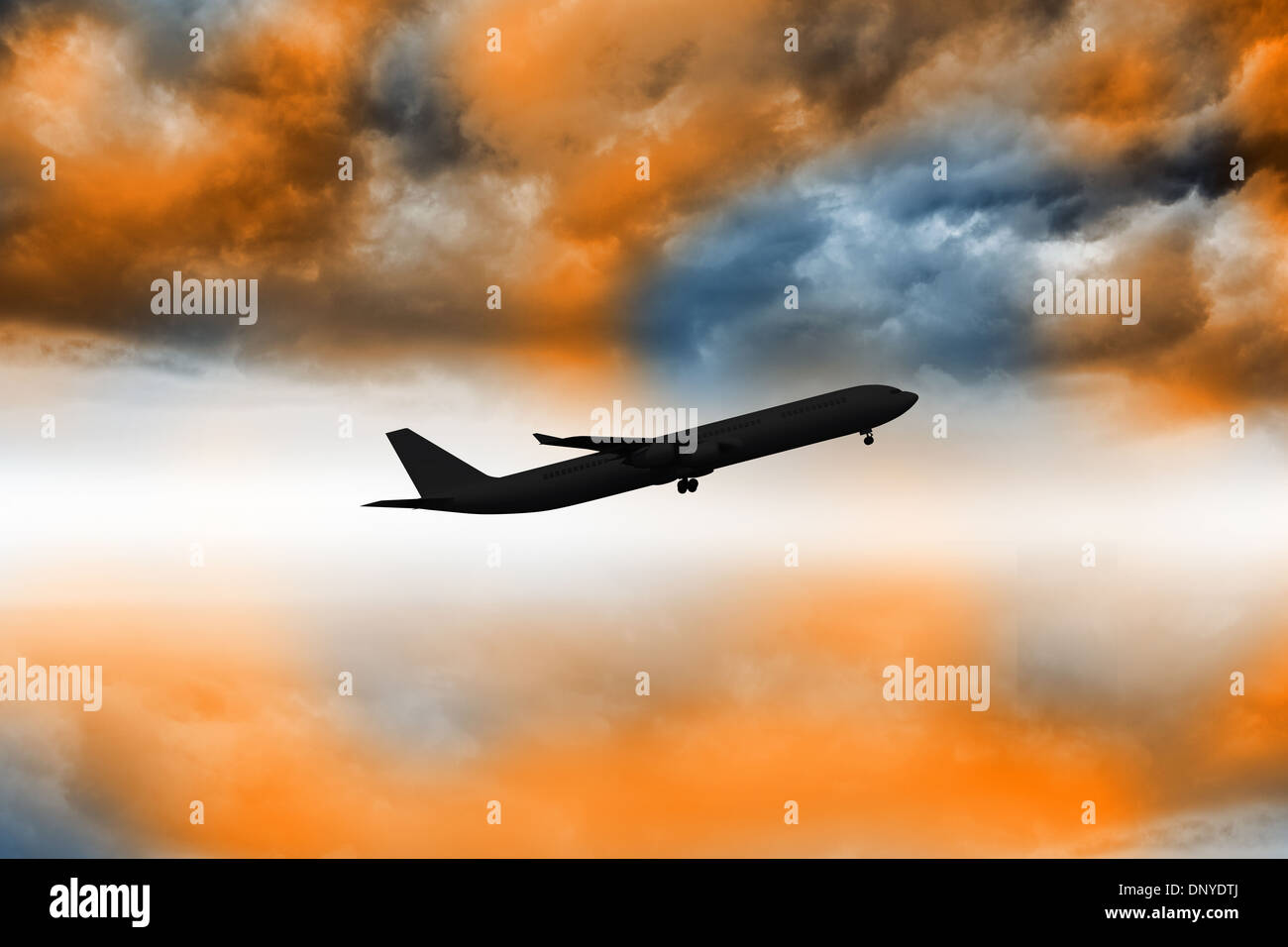 Airplane flying over orange sky - Stock Image