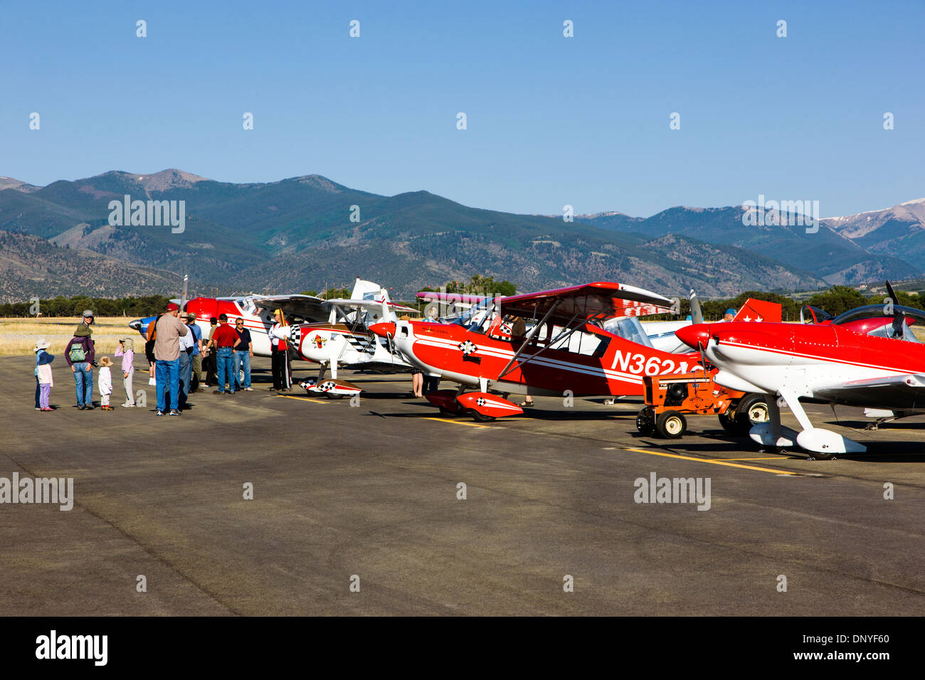 Visitors inspecting antique and modern airplanes at the annual Salida, Colorado,  ArtWalk Fly-In event Stock Photo