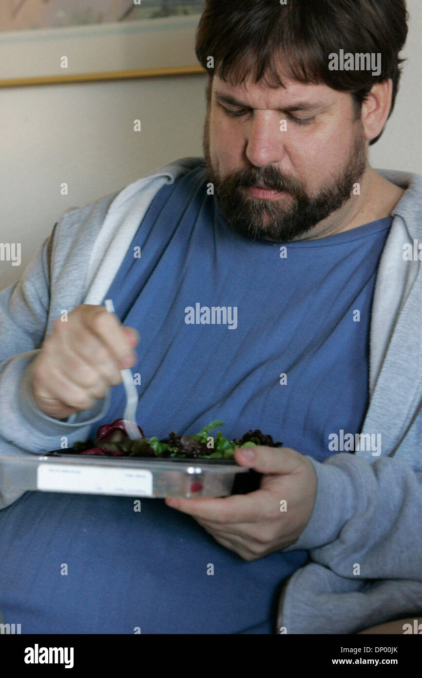 Feb 21, 2006; North Hollywood, CA, USA; STEVE VAUGHT eats (a salad) one of his new prepackaged meals at his hotel Stock Photo