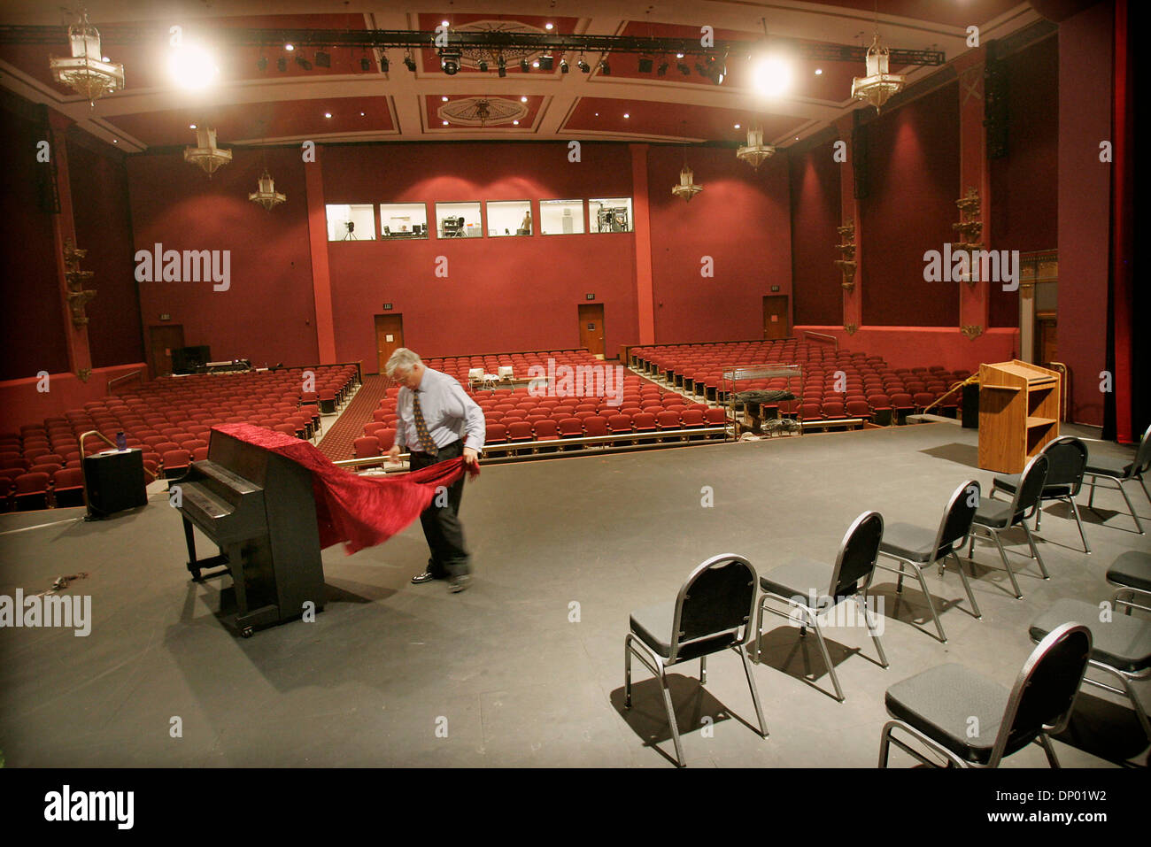 (Published 10/9/2005, F-4)  Jack Montgomery adjusted the drape on a piano as he prepared for opening night at  the North Park Theatre on University Avenue, September 29, 2005. - Stock Image