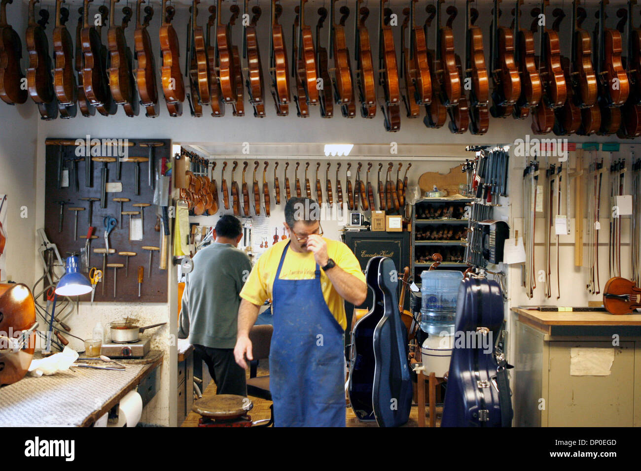Mar 13, 2006; Berkeley, CA, USA; Tired of working for Caterpillar as a mechanic, and with an appreciation for violin music, Jay Ifshin spent three years at the violin-making school in Salt Lake City.  With schooling completed, Jay bought a small violin shop in Berkeley that had been in business since the 1930's. At that time, there were only two part-time employees serving mostly l - Stock Image