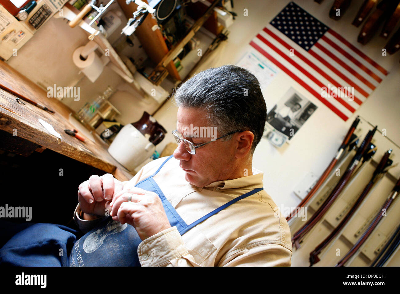 Mar 13, 2006; Berkeley, CA, USA; Bows are repaired and restrung with horsetail hair. Tired of working for Caterpillar as a mechanic, and with an appreciation for violin music, Jay Ifshin spent three years at the violin-making school in Salt Lake City. With schooling completed, Jay bought a small violin shop in Berkeley that had been in business since the 1930's. At that time, there - Stock Image