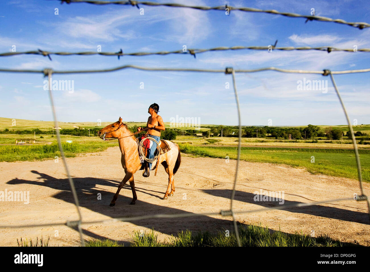 Jun. 01, 2006 - Wounded Knee, South Dakota, U.S. - GILBERT BLUE BIRD rides past the Wounded Knee Massacre Site outside Stock Photo