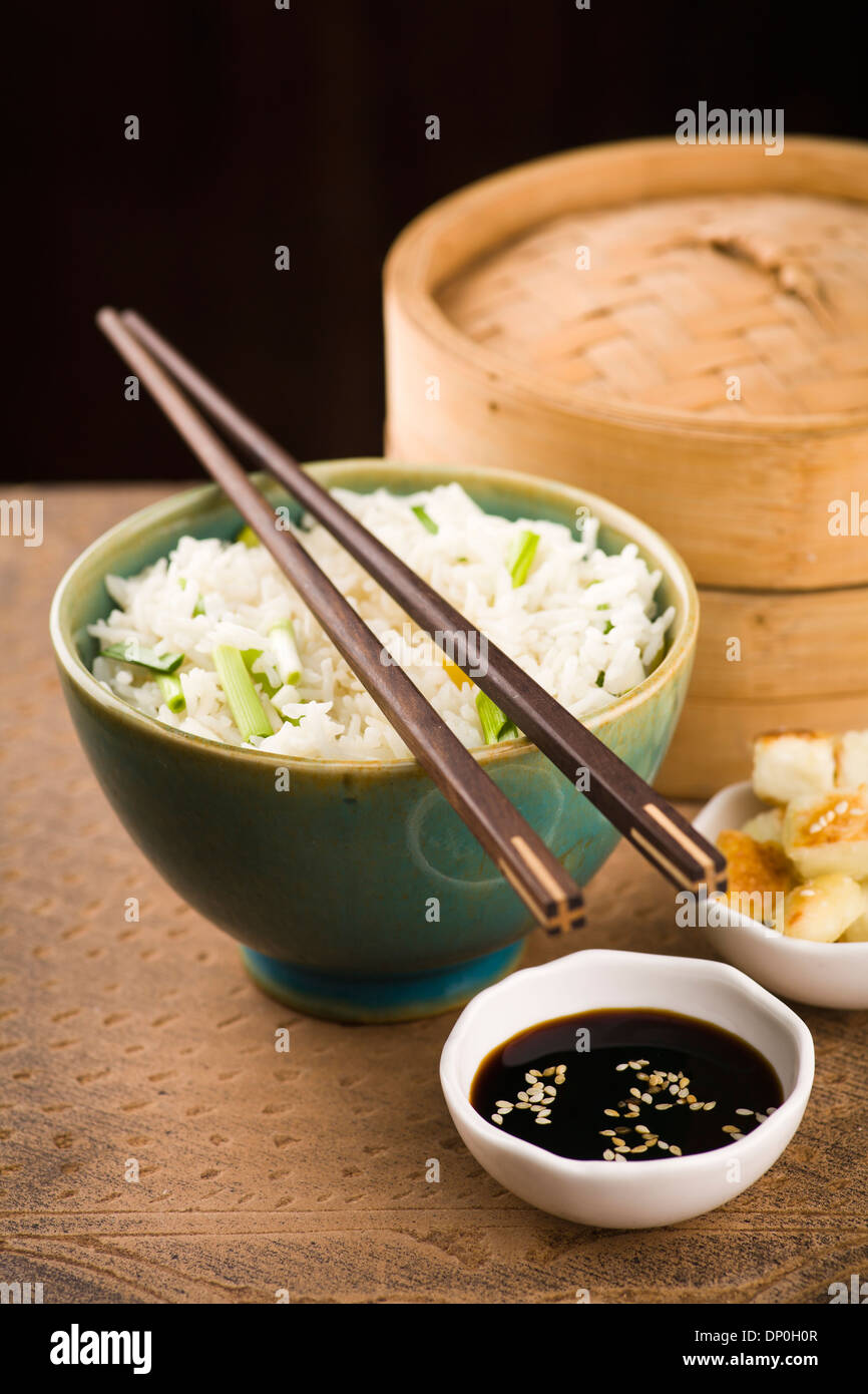 Bowl of lemon Rice with wild garlic and fried cheese - Stock Image
