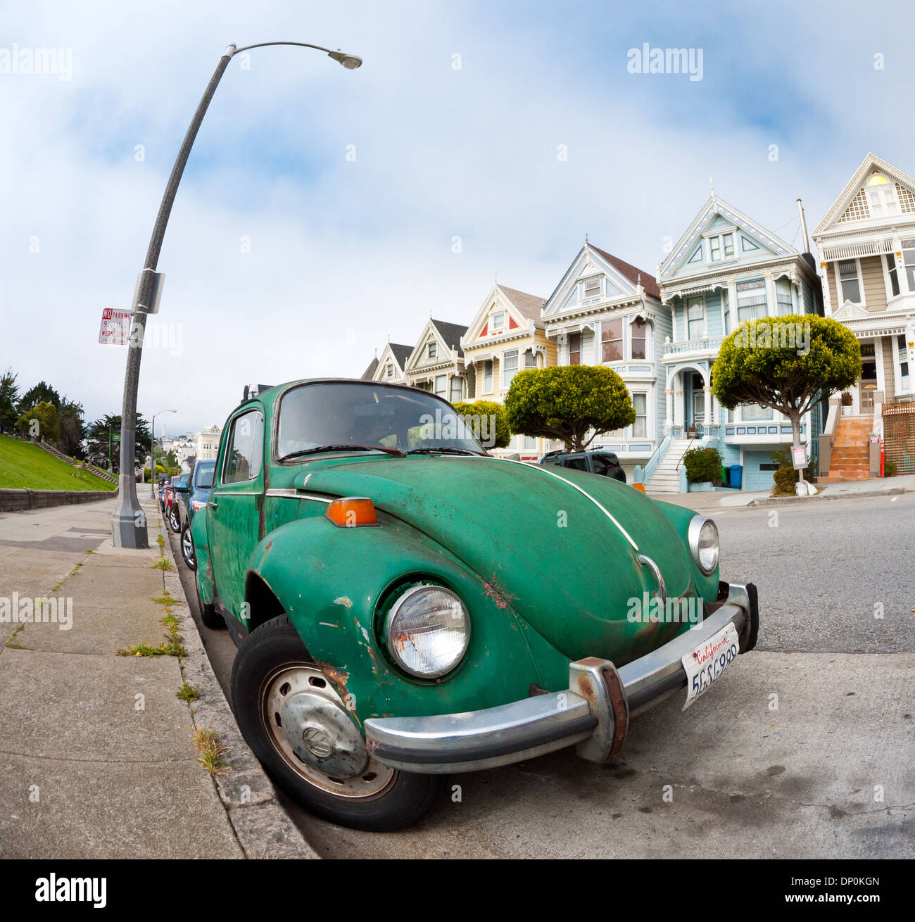 A fisheye view of a Volkswagen Beetle at Alamo Square on Steiner Street in San Francisco. - Stock Image