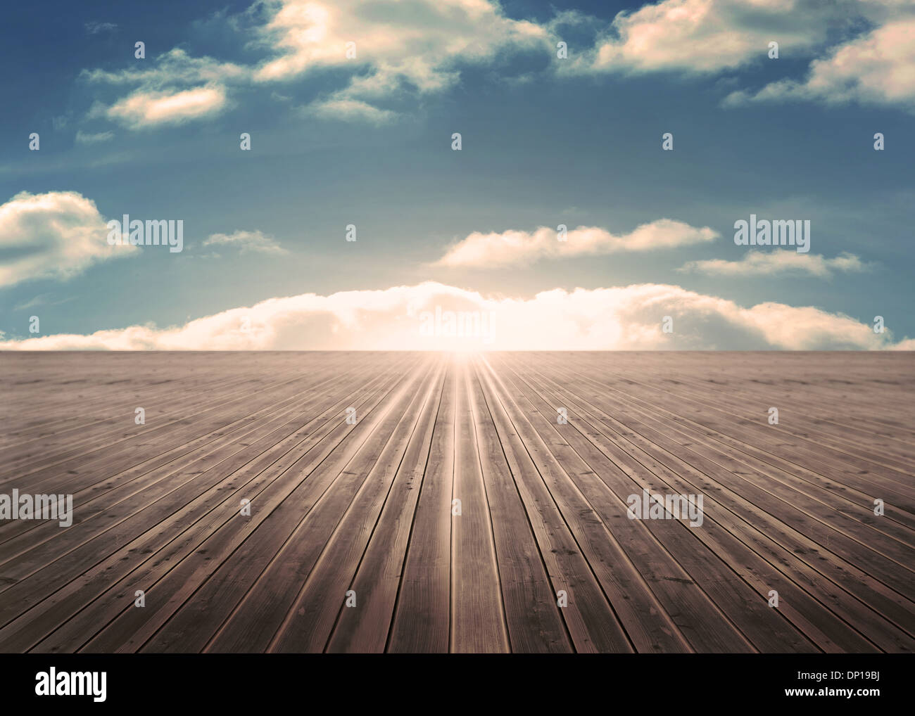 Wooden planks leading to blue sky - Stock Image