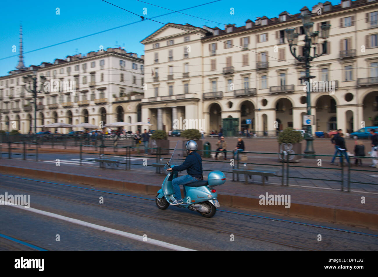 Panning motion shot of scooter at Piazza Vittorio Veneto square Turin city Piedmont region northern Italy Europe - Stock Image