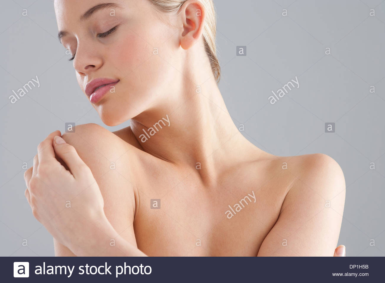 Portrait of bare chested woman - Stock Image