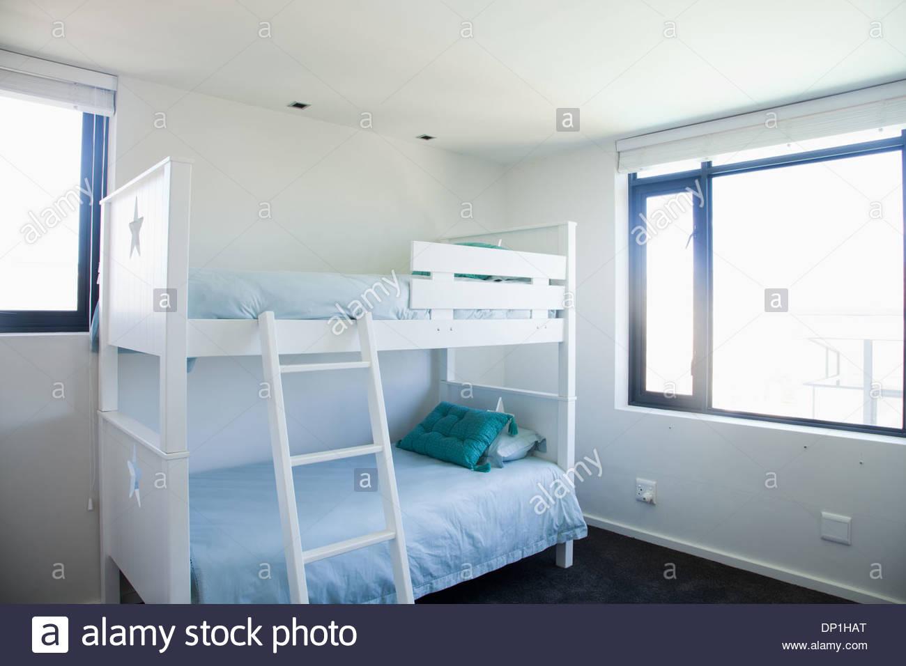 Bunk beds in childrenÂ's bedroom - Stock Image