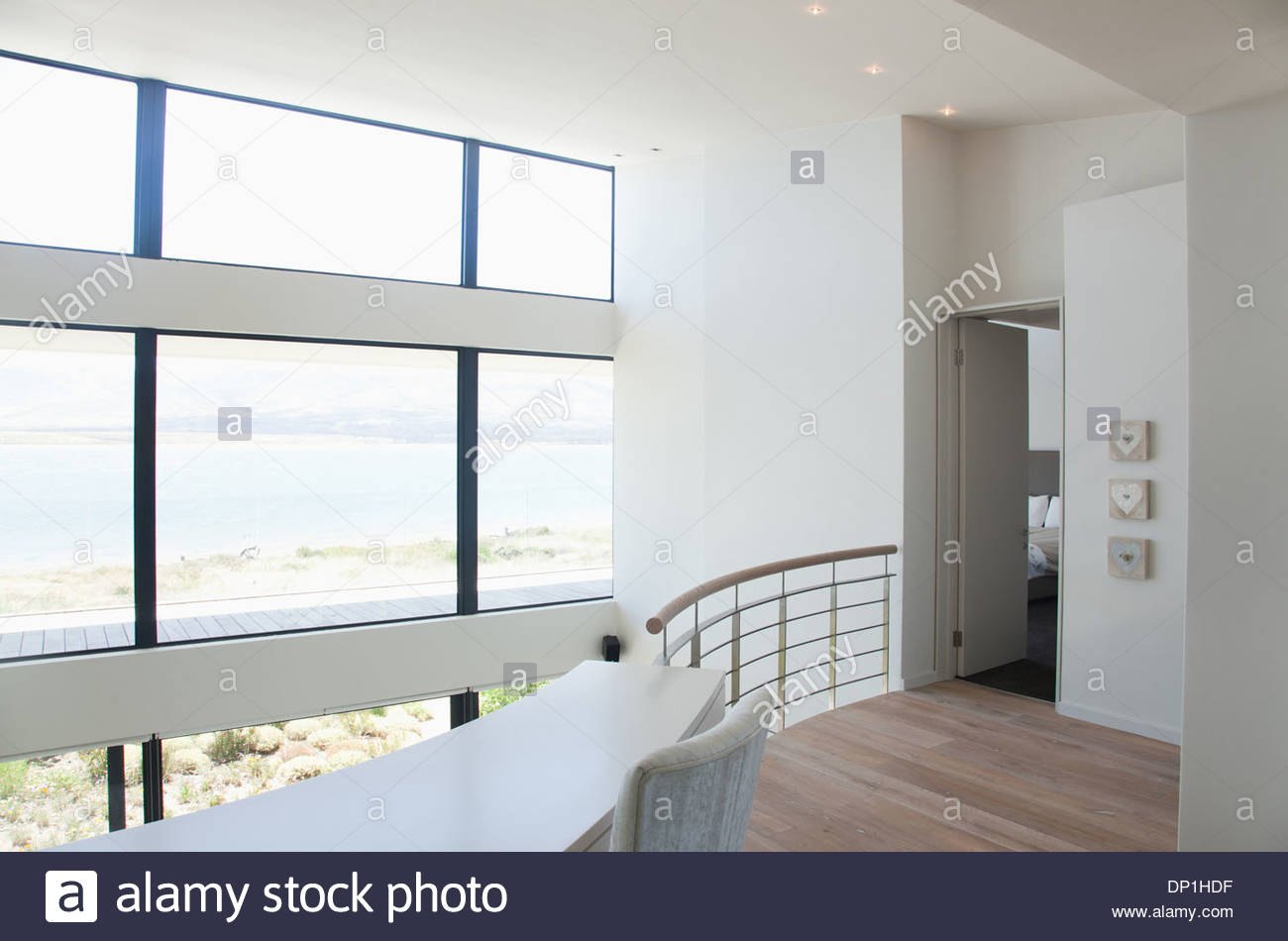View of lake from loft of modern house - Stock Image