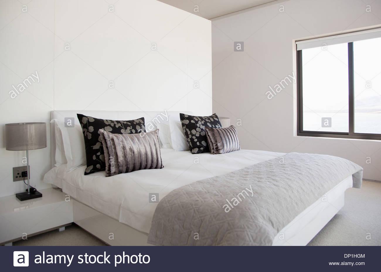 Bed in modern bedroom - Stock Image