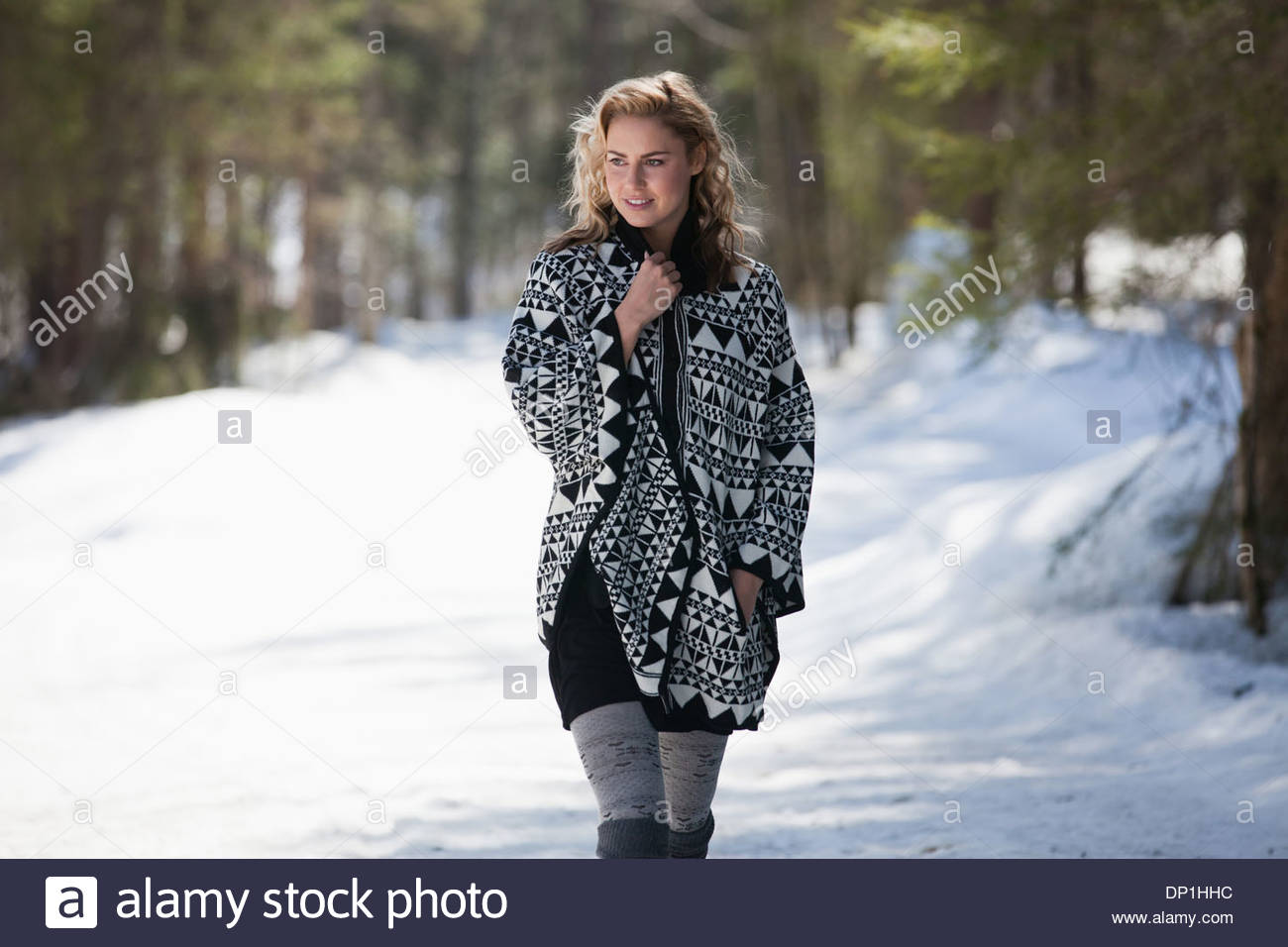 Woman walking in snow - Stock Image