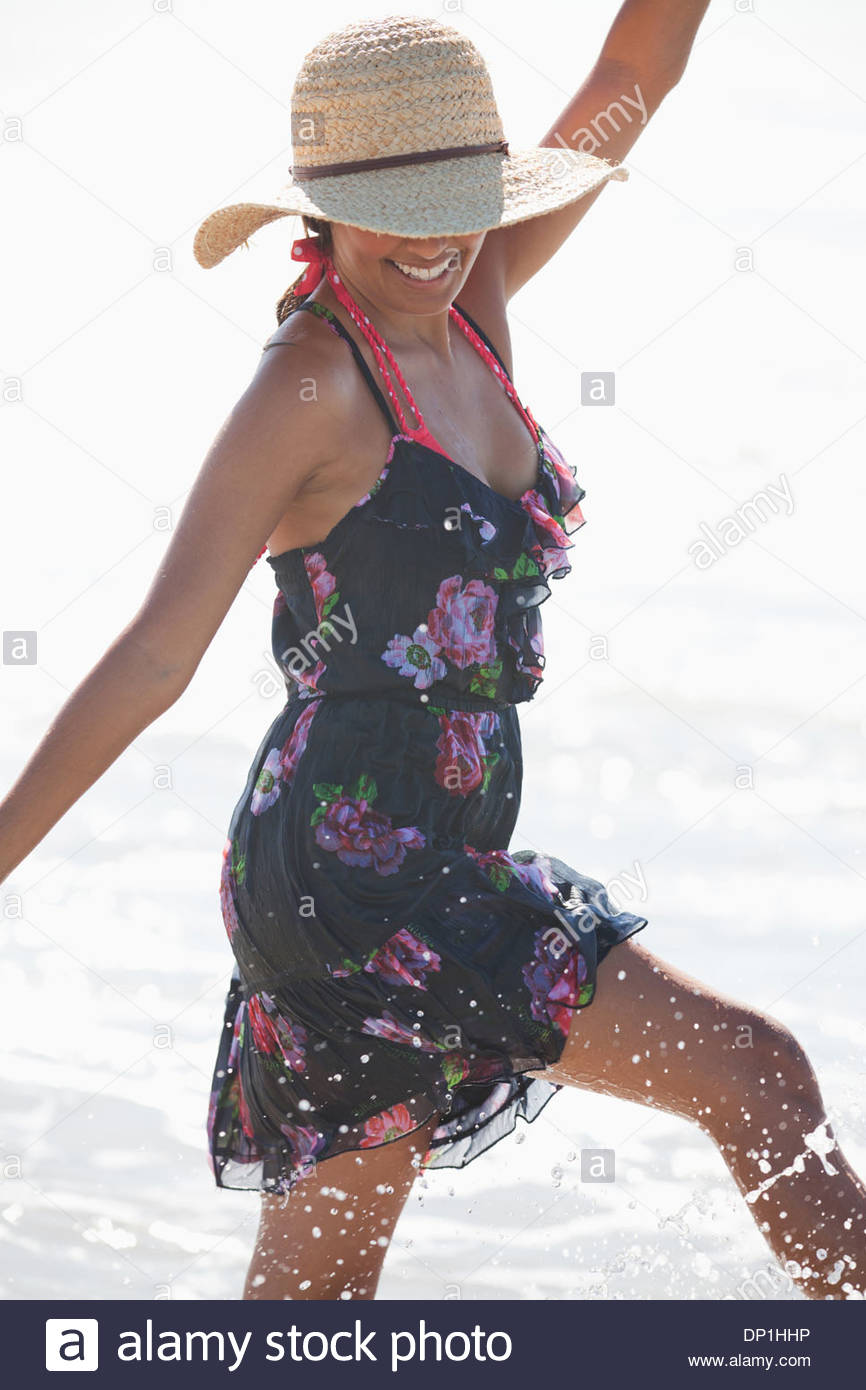 Woman playing in surf - Stock Image