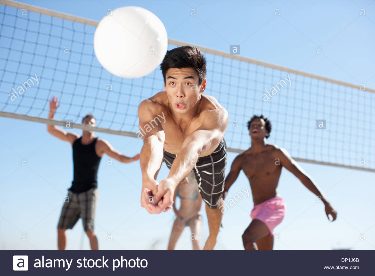 People playing beach volleyball - Stock Image
