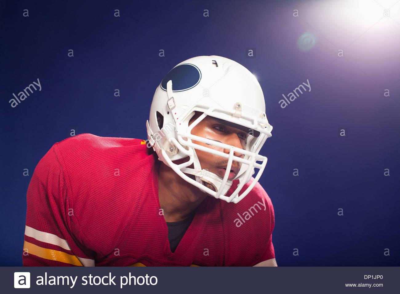 Football player wearing helmet - Stock Image