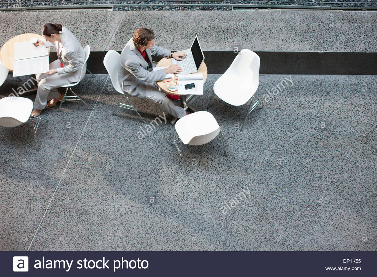 Businessman using laptop at table - Stock Image