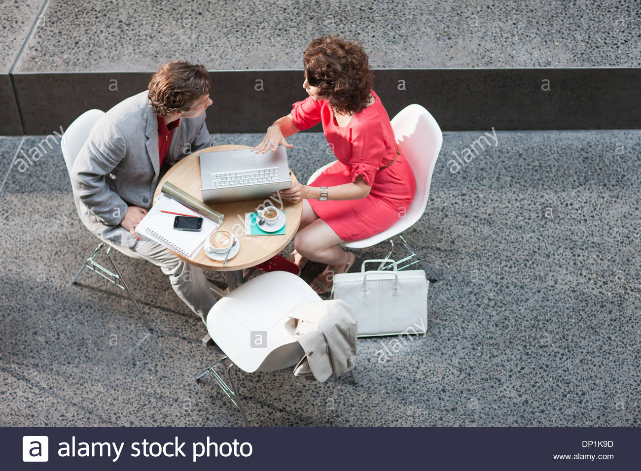 Businessman and businesswoman meeting at table - Stock Image