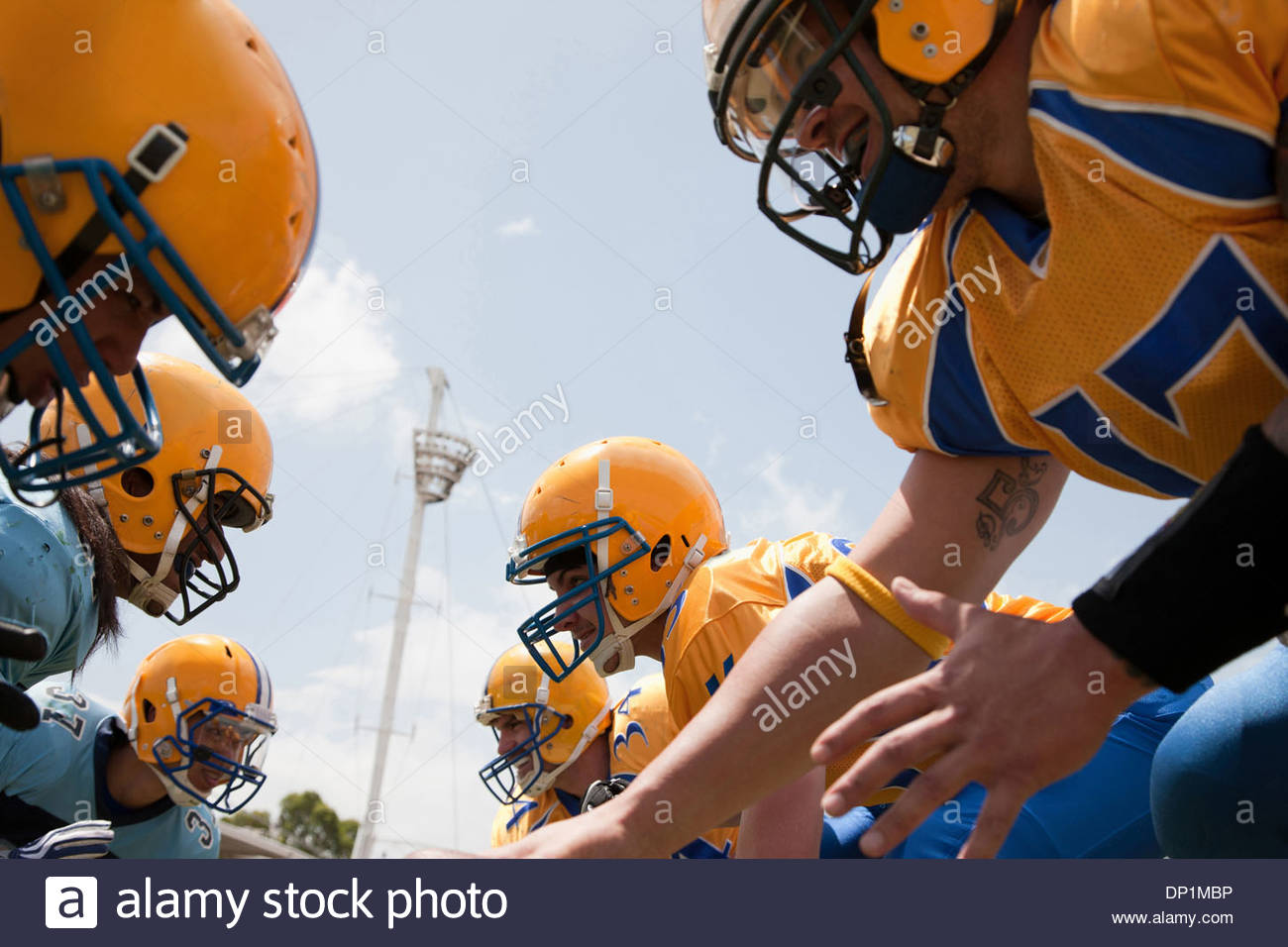 Football players preparing to play football - Stock Image