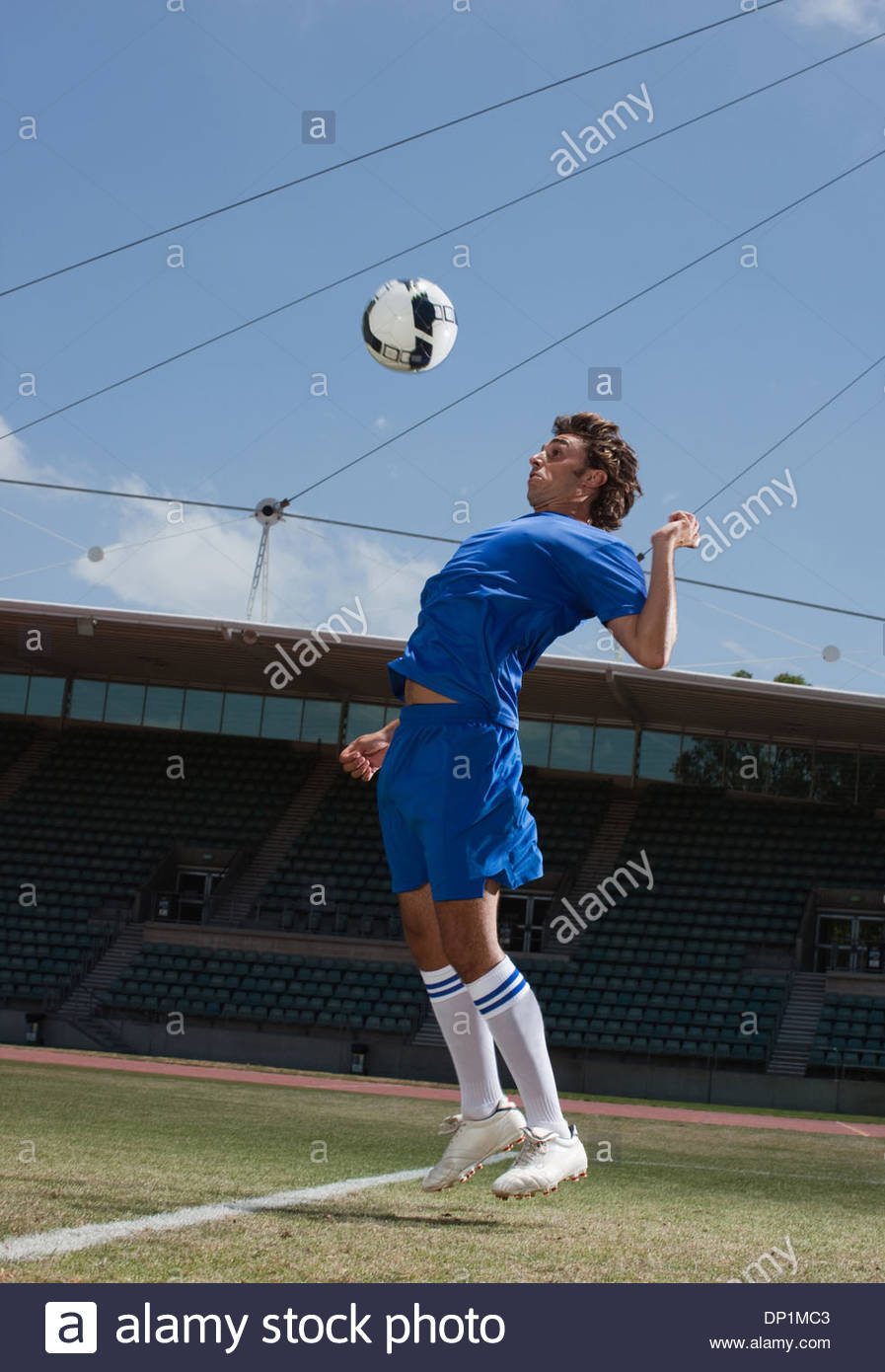 Soccer player playing soccer ball - Stock Image
