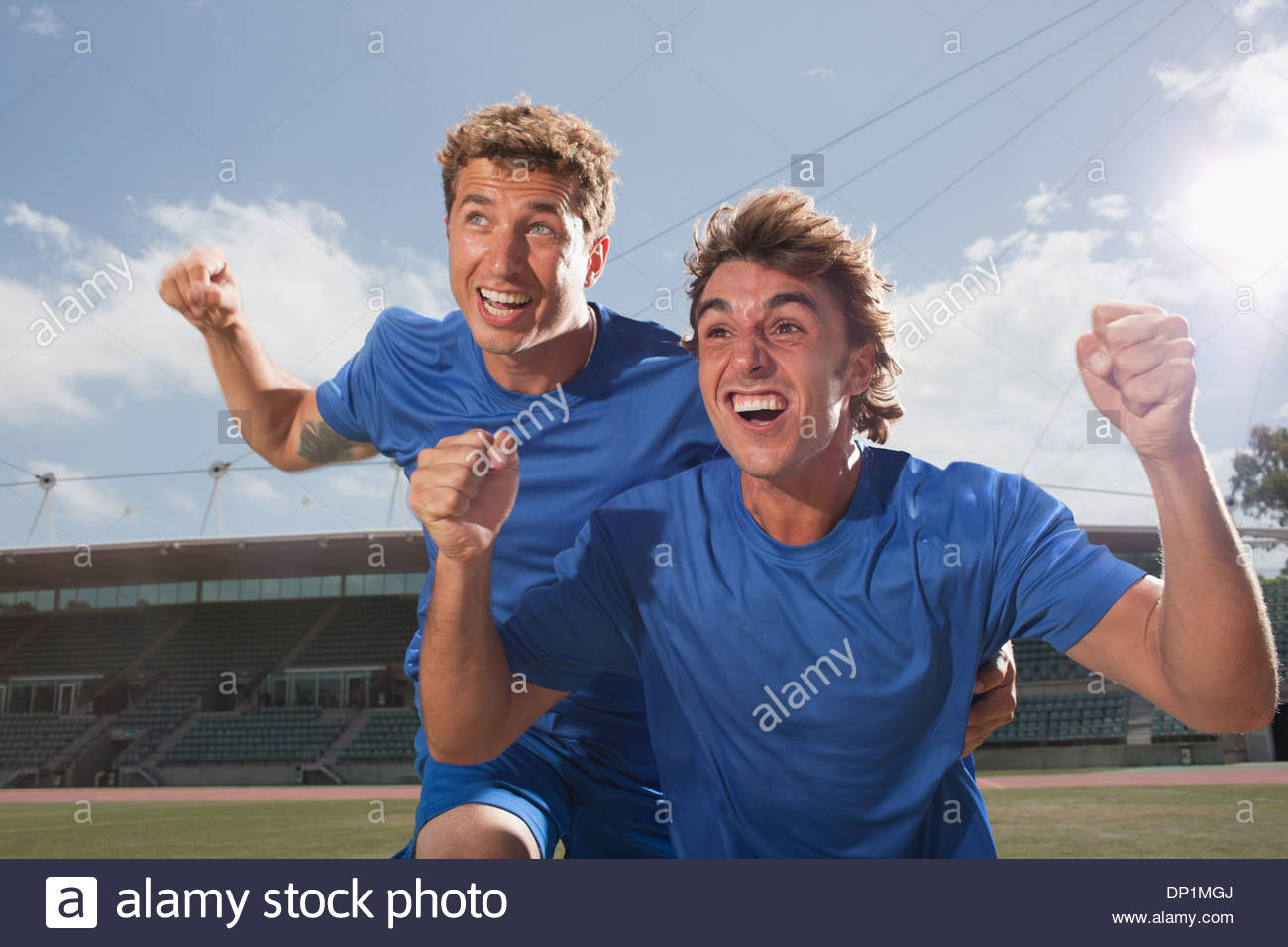 Soccer players cheering - Stock Image