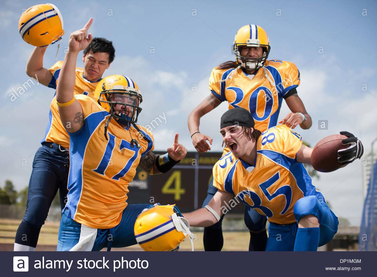 Winning football players cheering - Stock Image