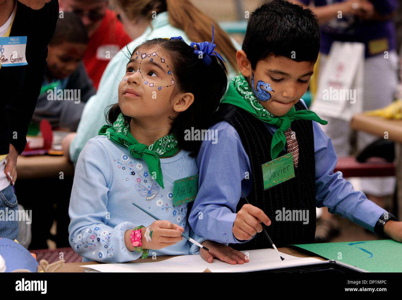 May 06, 2006; San Diego, CA, USA; ADELA, 5, left, and her brother, JAVIER, 6, participate in arts and crafts activities and listen to prospective adoptive parent at the County of San Diego Health and Human Services Agency's 5th Annual 'Spring Fling in the Park' at Admiral Baker Field in Mission Gorge. The event allows children and adoptive parents to meet children in a fun and rela - Stock Image