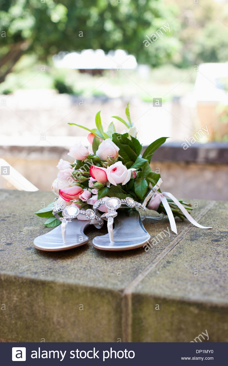 Bouquet and sandals - Stock Image