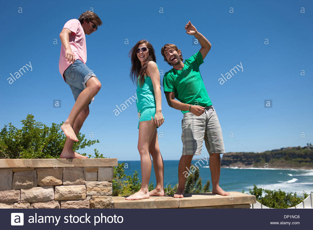 Friends playing on patio - Stock Image