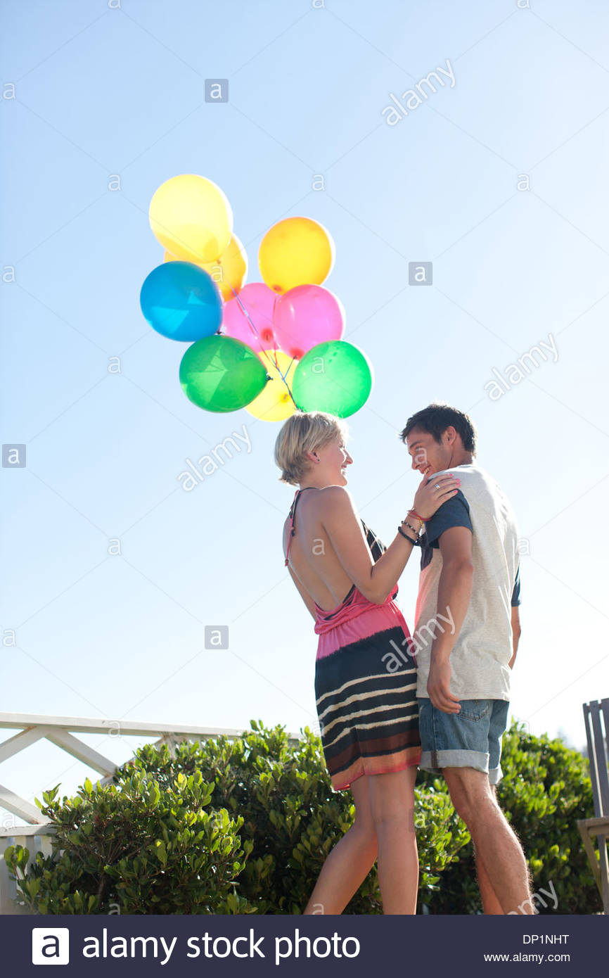 Couple with balloons - Stock Image