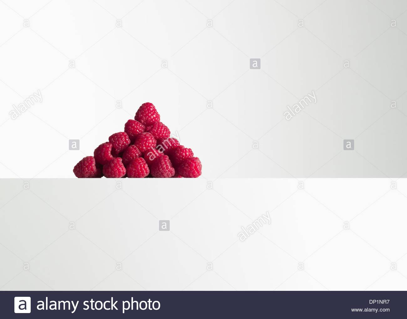 Raspberries in pile - Stock Image